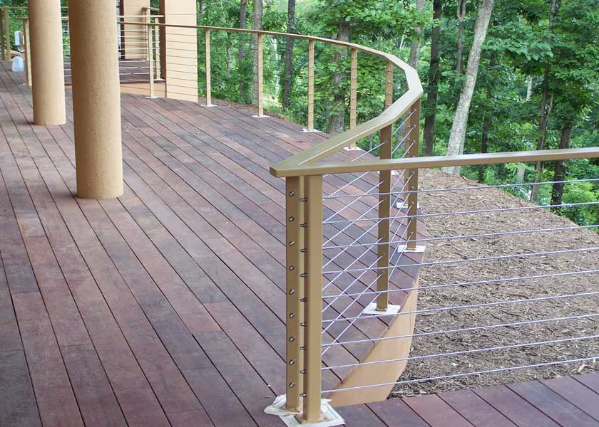 outdoor wood deck with steel cable railing fence