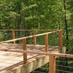 outdoor wood deck with metal cable railing