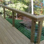 outdoor deck with steel cable railing overlooking landscaping