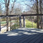 deck with steel cable railing overlooking trees