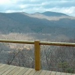 outdoor deck with steel cable railing overlooking mountains