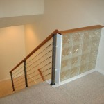 indoor stairs with protective metal cable railing