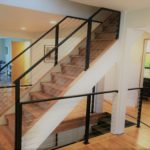indoor stairs with protective metal cable rails and fence